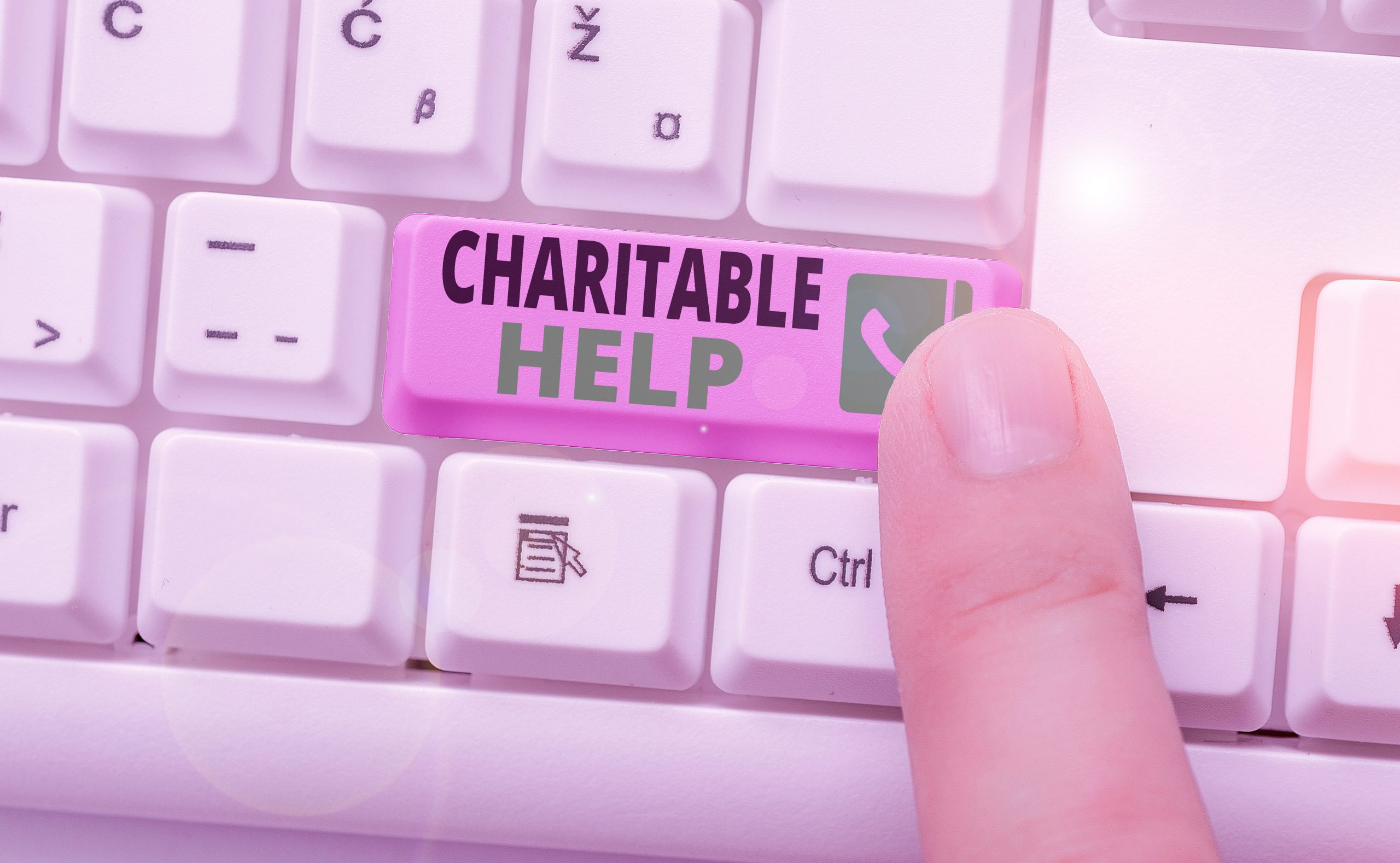photo of Conceptual hand writing showing Charitable Help