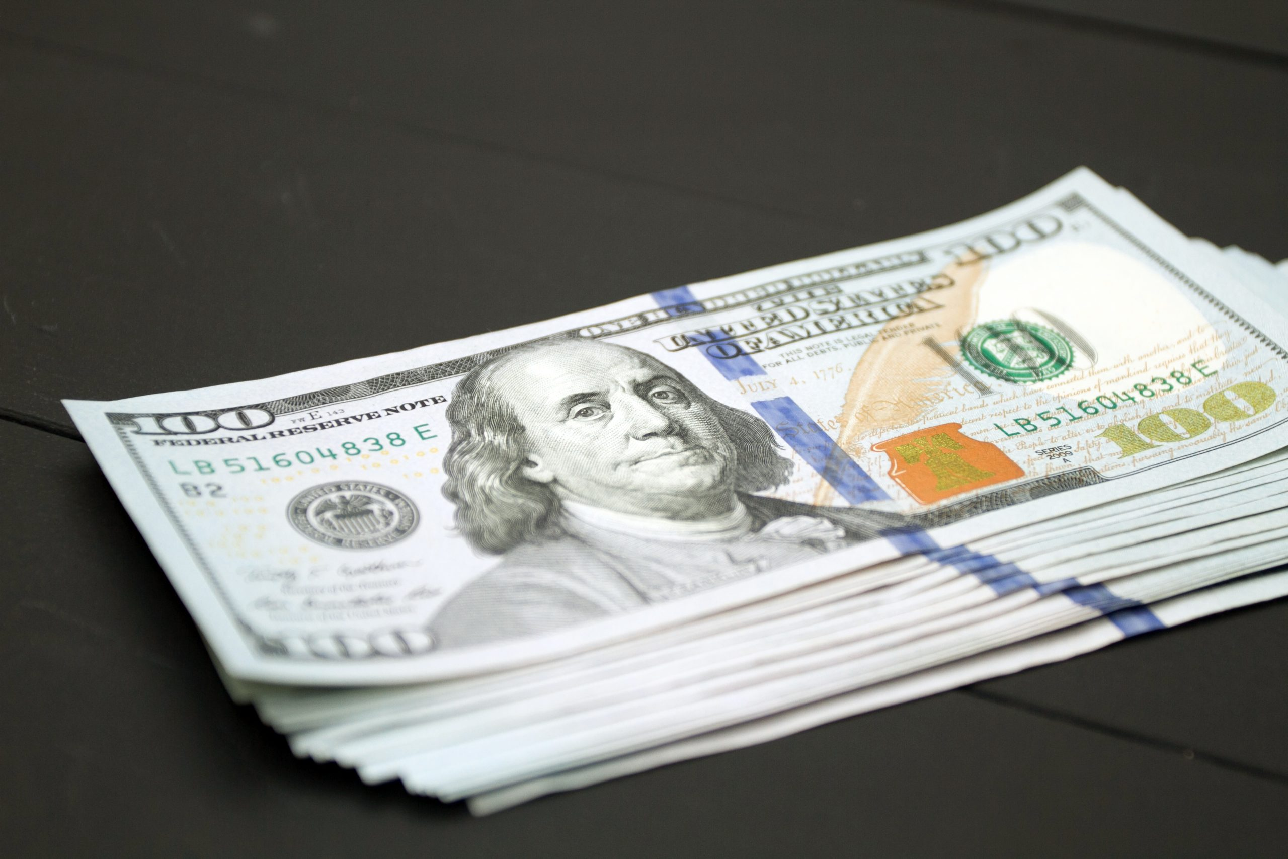 photo of Dollars money cash on a table