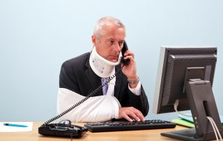 Photo of a mature businessman with injuries talking on the phone