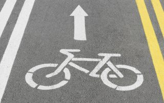 photo of bicycle sign on the road