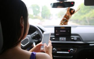 photo of a young woman hitting a pedestrian while texting and driving
