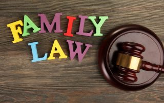 photo of A gavel and colourful letters regarding child-custody and family-law concept