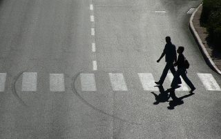 photo of pedestrians crossing the road