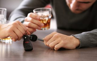 photo of a Woman taking car key from a drunk man in a bar to avoid drunk driving