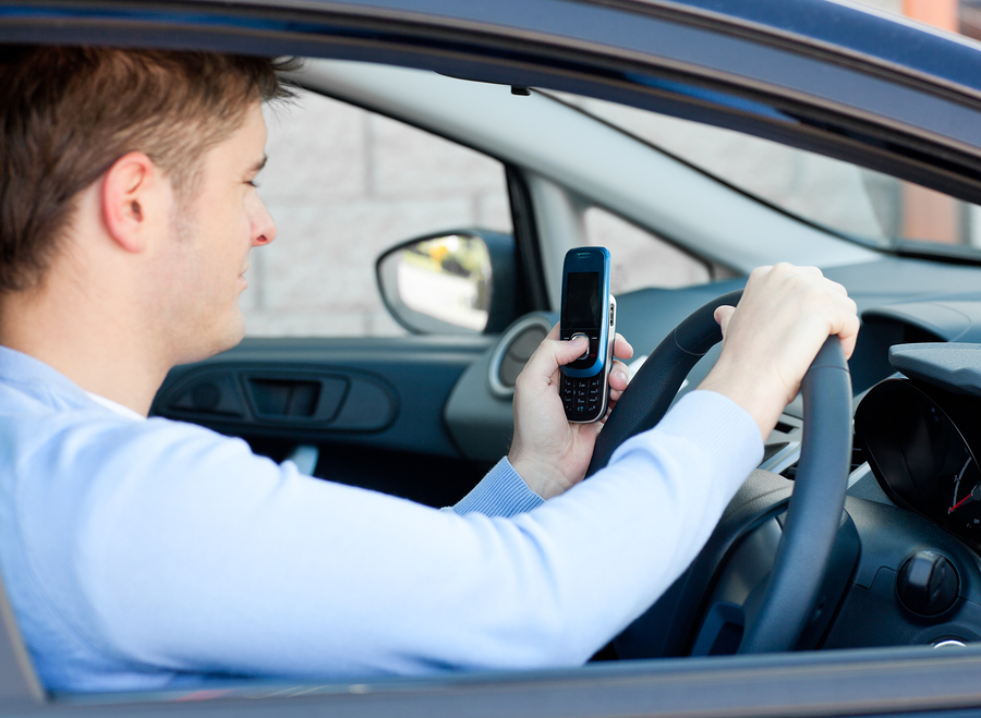 photo of a Man Sending A Text Message While Driving
