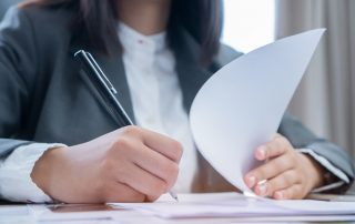 photo of Business Woman Checking And Signing Paperwork