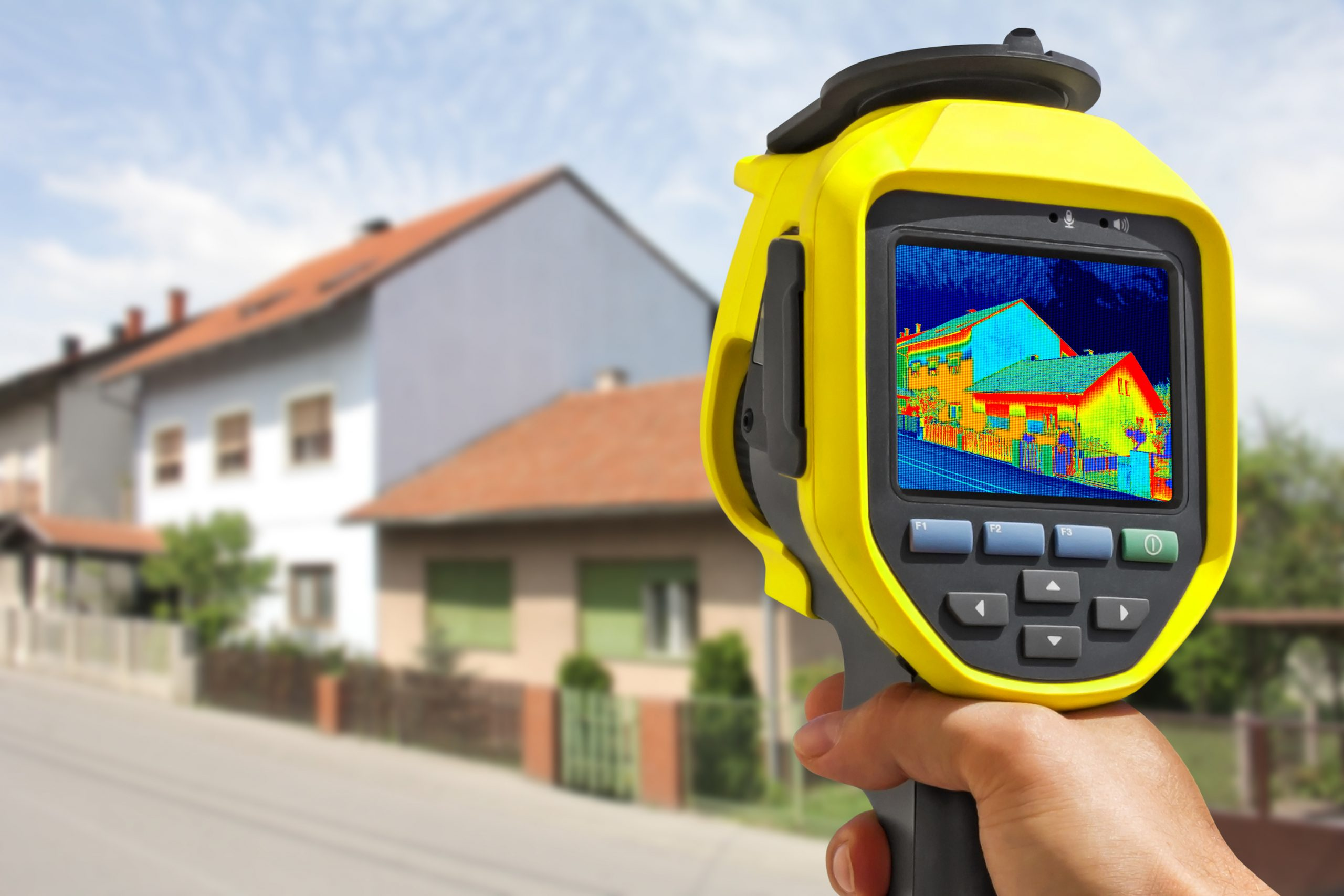photo of a Man Recording Heat Loss at the House With Infrared Thermal Camera