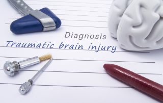photo of medical diagnosis of Traumatic brain injury written on a paper