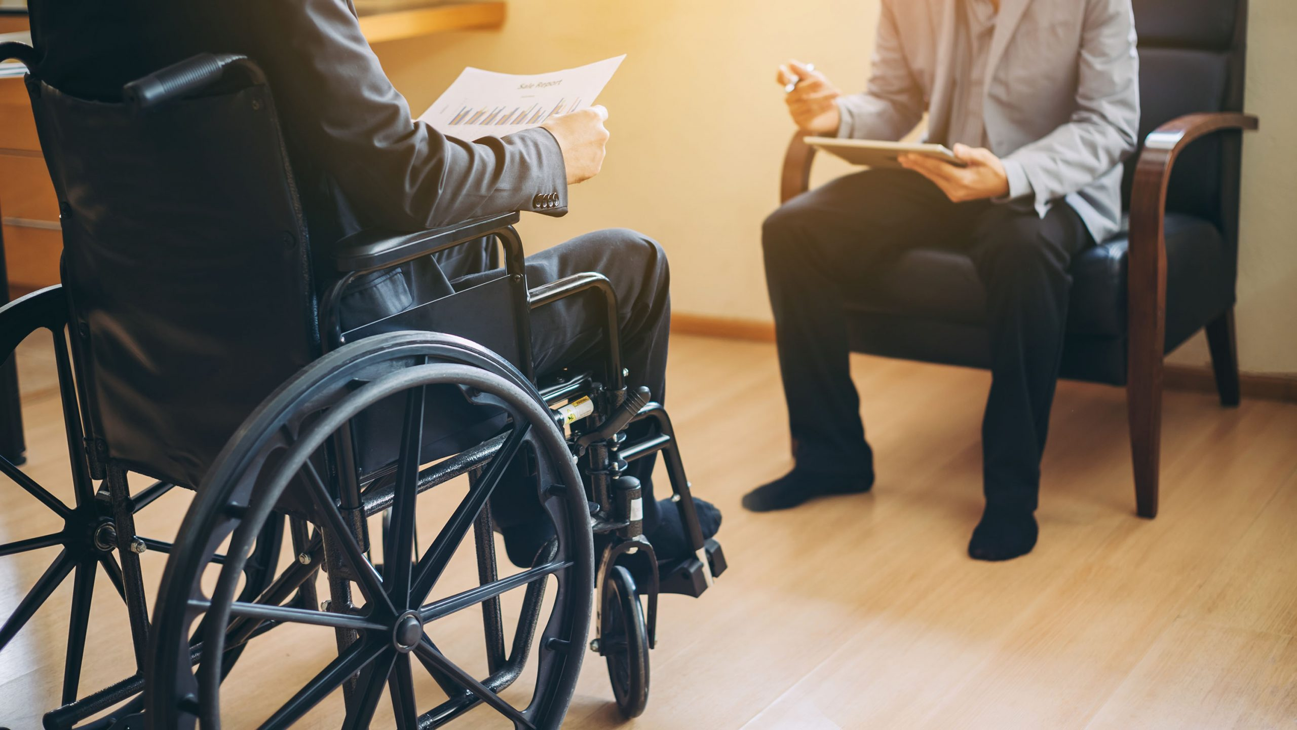 photo of a business man on a wheelchair