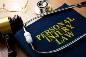 photo of Personal Injury Law Book and stethoscope