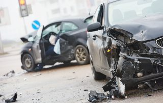 picture of two cars damaged after the collision