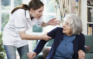 Picture of Care Worker Mistreating Senior Woman At Home