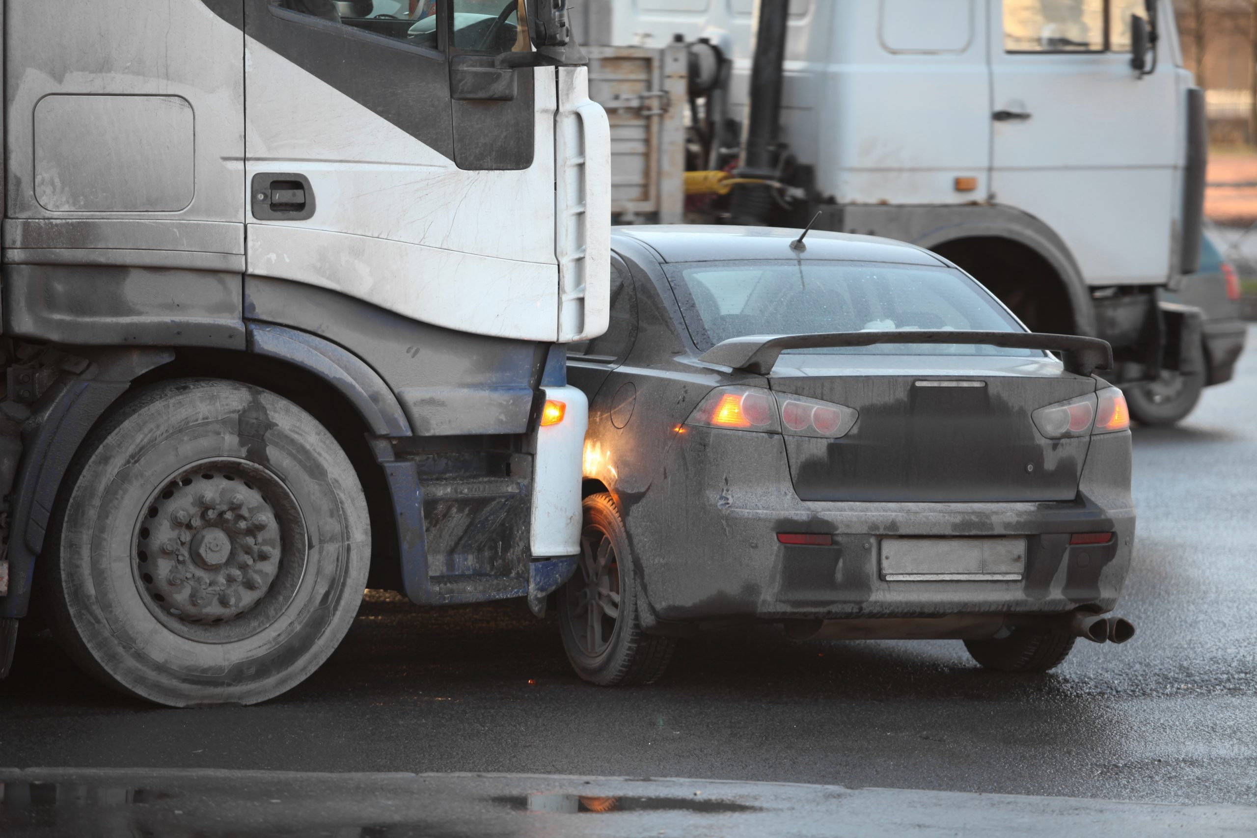 photo a car being hit by a truck in an accident