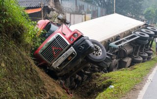 photo of a rollover truck on the side of the road