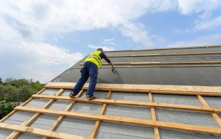 a roofer working on a roof where several safety issues related to roofing accidents are present